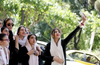 Women pose for a photo while showing their support for Tehran's mayor at a rally in May 2017.