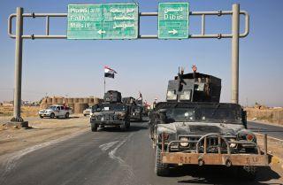 Iraqi forces move toward Kirkuk on Oct. 16.
