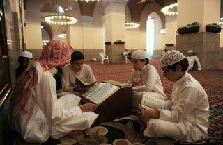 Saudis read the Koran at a mosque in Jeddah.