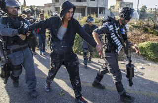 Israeli security forces detain an Arab-Israeli youth during clashes.