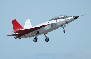 A Japanese X-2 experimental stealth fighter takes off from Komaki airport in Japan on April 22, 2016.