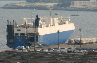 A car transport ship sits at anchor at the Nissan Motor's Oppama plant in Yokosuka, Japan, on Nov. 26, 2018.