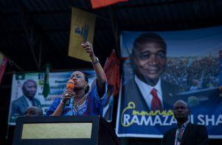 Olive Kabila, the wife of President Joseph Kabila, speaks during an election rally.