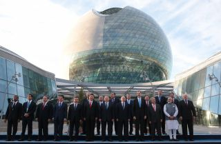 Heads of state stand in front of the EXPO 2017 exhibition in Astana, Kazakhstan on June 9.