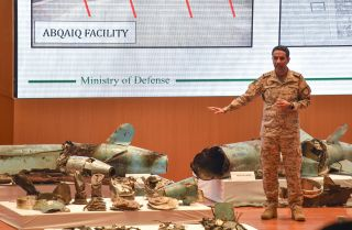Saudi Defense Ministry spokesman Col. Turki al-Malki displays pieces of what he said were Iranian cruise missiles and drones recovered from an attack on Saudi oil facilities, during a press conference in Riyadh on Sept. 18, 2019.