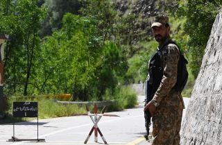 This photo shows a lone Pakistani soldier patrolling the Line of Control, the de facto border between Pakistan and India, in Pakistan-administered Kashmir on Aug. 29, 2019.
