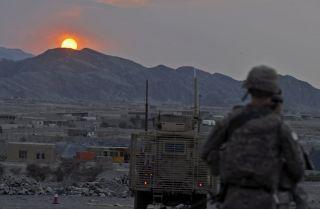A U.S. soldier watches the sun go down near Turkham, Afghanistan.