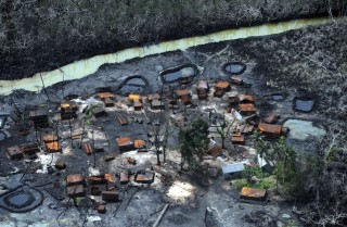An illegal oil refinery that was destroyed by Nigerian forces at Nembe Creek in the Niger Delta on March 22.