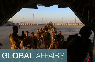 U.S. Marines board a plane as part of the withdrawal from a base in Afghanistan's Helmand province in 2014.