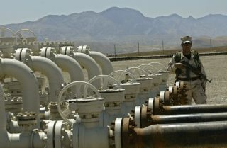 An Iraqi Kurdish soldier stands guard at the Tawke oil field near the town of Zacho in Dohuk province.