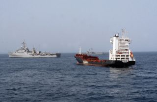 The USS Dubuque (L) with the Turkish frigate TCG Gokceada during the seizure of the MV Magellan Star on Sept. 9