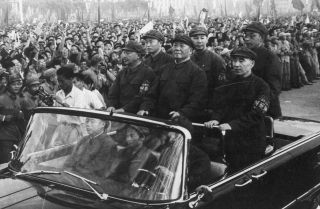 Chinese leader Mao Zedong accompanied by second-in-command Lin Biao passes through a 1966 Tiananmen Square rally.