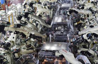 Automated welding machine robots assemble automobile bodies at Toyota Motor's Tsutsumi plant in Toyota, Japan.