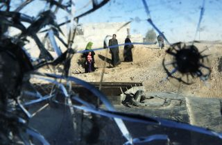 A picture taken through a vehicle's bullet-riddled windshield shows Mosul after Iraqi troops retook most of the city from the Islamic State. The group's so-called caliphate looks nothing like the caliphates of old, which thrived on diversity.