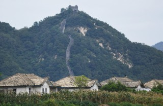 North Korean houses rest in front of the Great Wall of China near the town of Sinuiju.