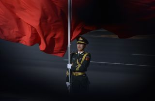 A member of China's honor guard waits to receive Vietnamese President Tran Dai Quang and Chinese President Xi Jinping in Beijing on May 11.