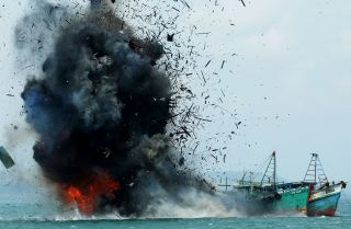 The Indonesian government blows up a foreign fishing vessel in its waters earlier this year.