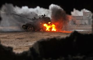 A tank burns as clashes rage between the Libyan National Army, led by Field Marshal Khalifa Hifter, and jihadist militants.