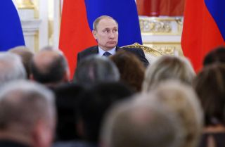 Russian President Vladimir Putin attends a session at the Kremlin in Moscow on June 23.