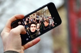 A picture of a smartphone. Powerful handheld devices and social applications are changing the way people communicate, organize and protest.