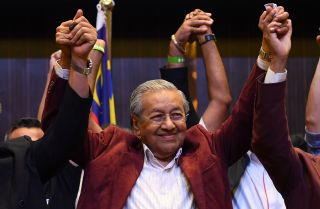 Mahathir Mohamad, who served as Malaysia's prime minister from 1981-2003, celebrates his victory and return to power in the country's election in May 2018.