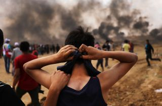 A Palestinian teenager prepares to head to the border fence with Israel amid mass demonstrations against the opening of the U.S. embassy in Jerusalem on May 14 -- the day before Ramadan -- in Gaza City.