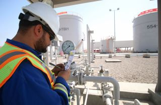An employee works at the Rumaila natural gas power station in southern Iraq. Like most countries in the Middle East, Iraq relies on natural gas for much of its electricity generation.