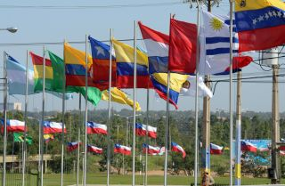 Flags of the countries that are full and associate members of Mercosur, the South American trade bloc. Political changes and recession in Argentina and Brazil have pushed the group to try to liberalize its trade policies.