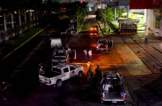 In this photograph, police investigate the killing of a colleague in Acapulco, Mexico, on July 23, 2018.