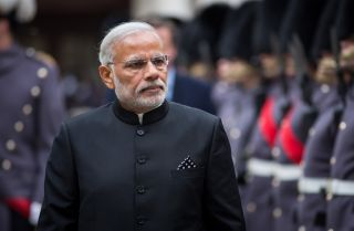 Indian Prime Minister Narendra Modi inspects an honor guard in London.