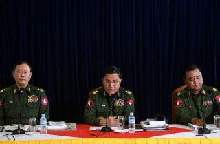 Myanmar army generals Tun Tun Nyi, Soe Naing Oo and Zaw Min Tun (left to right) discuss their intent to thwart constitutional changes by the governing National League for Democracy.