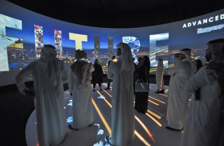 Viewers watch a promotional video touting Saudi Arabia's proposed new megacity, Neom, during an investment conference in Riyadh on Oct. 25, 2017.