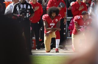 Quarterback Colin Kaepernick kneels during a protest during the playing of the national anthem before a San Francisco 49ers game in 2016.