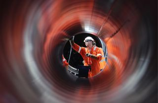 A worker constructs a section of the Nord Stream 2 natural gas pipeline near Kingisepp, Russia.