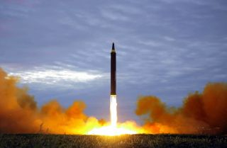 An image released by North Korea's official Korean Central News Agency shows the launch of a Hwasong-12 intermediate-range ballistic missile on Aug. 29, 2017.