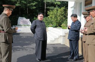 In this photo, North Korean leader Kim Jong Un visits the Chemical Material Institute of the Academy of Defense Science at an undisclosed location.