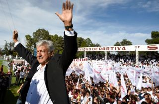Mexican presidential candidate Andres Manuel Lopez Obrador stands at a campaign rally.