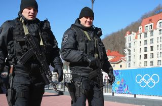 Police patrol around the Rosa Khutor Mountain Cluster village ahead of the 2014 Winter Olympics in Sochi, Russia.