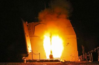 The guided-missile cruiser USS Monterey fires a Tomahawk land attack missile on April 13, 2018, against the Syrian government.
