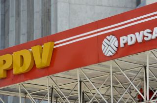 A photograph shows the logo of Venezuelan state-owned oil company PDVSA at a gas station in Caracas during November 2017.