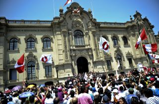 Peruvians gather outside the presidential palace in Lima