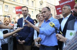Pawel Kukiz, leader of Poland's Kukiz' 15 party, speaks to the press in Krakow on Sept. 4, 2019, about the Polish Coalition, an alliance between his party and the Polish People's Party formed to compete in Poland's general elections this fall.