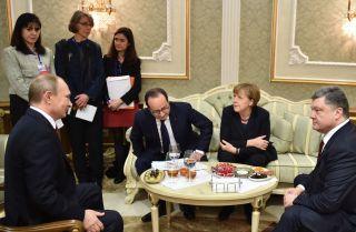 Russian President Vladimir Putin, Former French President Francois Hollande, German Chancellor Angela Merkel and Ukrainian President Petro Poroshenko (L-R) attend a meeting in February 2015 to discuss the conflict in Ukraine.