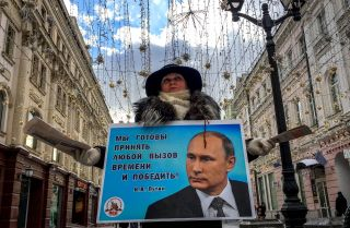 An activist distributes election leaflets in support of Russian President Vladimir Putin in Moscow on March 16.