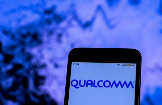 A smartphone displays Qualcomm's company logo.