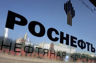 The walls surrounding the Kremlin arereflected on aplaque at the entrance of the oil company Rosneft's headquarters in Moscow.
