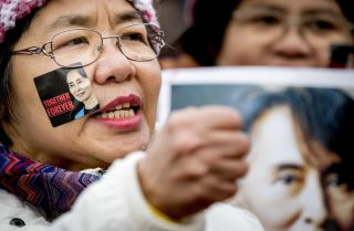 Supporters of Aung San Suu Kyi gather in The Hague, Netherlands, as the 1991 Nobel Peace Prize laureate defended Myanmar's military against allegations of ethnic cleansing and genocide before the International Court of Justice on Dec. 12, 2019.