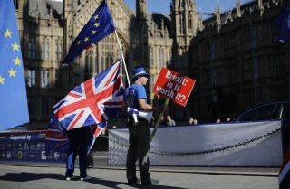 An anti-Brexit protester stands outside the British Parliament in London on Oct. 9, 2018.