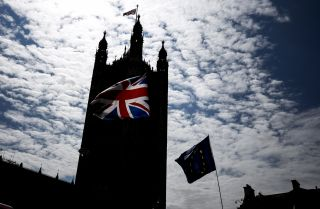 A Union Flag waves outside the Houses of Parliament in London on July 12, 2019.