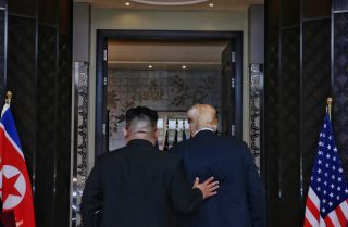 North Korean leader Kim Jong Un follows U.S. President Donald Trump into Singapore's Capella Hotel for their summit June 12.